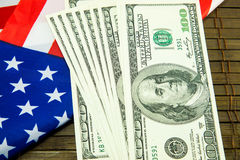 American dollars and flag. Royalty Free Stock Images