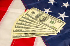 American dollars and flag. Royalty Free Stock Photos