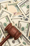 American dollars and gavel. Royalty Free Stock Photography