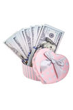 American dollars in a gift box. American dollars in a heart shaped gift box on white Stock Images