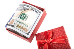 American dollars in gift box. American dollars in a gift box on white Royalty Free Stock Images