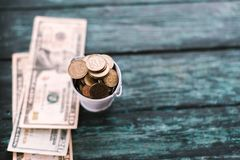 American dollars on a green wooden background royalty free stock photography