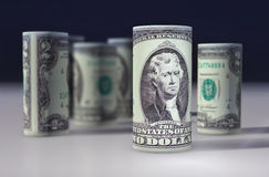 American 2 dollars greenback rolled up on the black.  Royalty Free Stock Photography