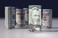 American 50 dollars greenback rolled up on the black.  Royalty Free Stock Image