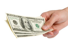 American dollars in a hand Stock Images