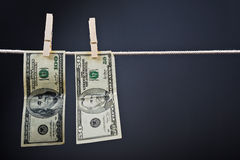 American Dollars hanging on rope Stock Photo