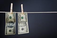 American Dollars hanging on rope Stock Photo