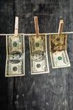 American Dollars hanging on rope Stock Image