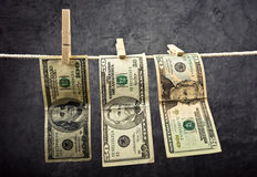 American Dollars hanging on rope Stock Images