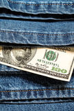 100 American dollars on jeans background. Financial concept Royalty Free Stock Photography