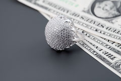 American dollars and jewelry diamond ring royalty free stock images