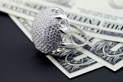 American dollars and jewelry diamond ring stock images