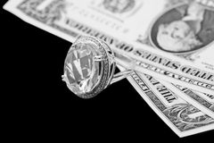 American dollars and jewelry diamond ring royalty free stock photo