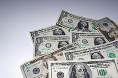 American dollars laid out in a corner. American dollars are laid out in a corner of the picture on white background stock photography