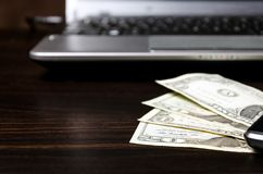 American dollars money and laptop computer Royalty Free Stock Image