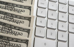American dollars near computer keyboard calculator Royalty Free Stock Photo