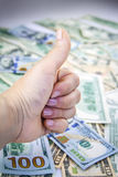 American dollars and OK sign hand Royalty Free Stock Images