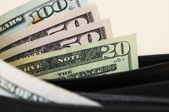 American dollars are partially visible with a purse stock photo