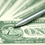 American dollars and pen royalty free stock photos