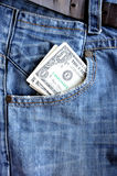 American Dollars in the pocket of blue jeans. Vertikal Stock Images