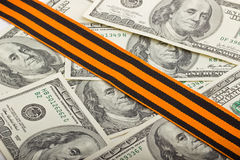 American dollars and St. George ribbon. On top Royalty Free Stock Images