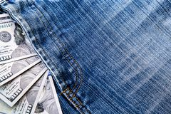 American dollars sticking out of the blue jeans pocket. Business concept exchange. royalty free stock photos