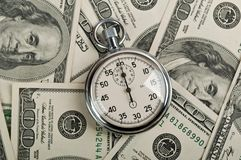 American dollars and stopwatch Royalty Free Stock Images