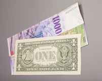 American dollars and Swiss franc currency Stock Photo