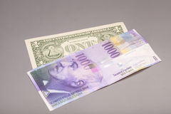 American dollars and Swiss franc currency Stock Image