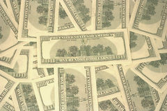 American dollars texture. Many rear side One Hundred Dollars as background Stock Photography