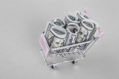 American Dollars in trolley. Some American Dollars in a small shopping cart Stock Photo