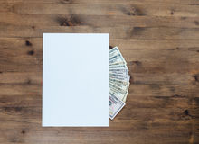 American dollars under paper Royalty Free Stock Image