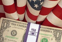 American dollars and USA flags Stock Image