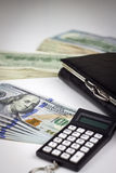 American dollars with wallet and calculator Stock Photography