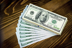 American dollars on wood background Royalty Free Stock Photo