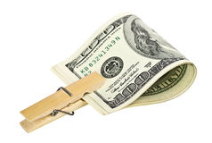 American dollars with a wooden clothespin Stock Images