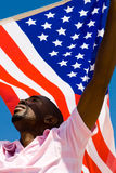 American dream. Young african american man waving with USA flag, american dream concept Royalty Free Stock Photography