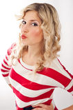 American-dressed girl gives a kiss Stock Images