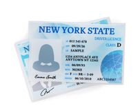 American driving licenses on white background. Top view royalty free stock image