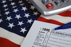 income tax form on American flag Stock Photos