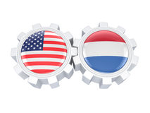 American and Dutch flags on a gears. Royalty Free Stock Photo