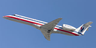 American Eagle Airlines American Airlines Embraer ERJ-140 aircraft taking off from Los Angeles International Airport. Los Angeles, California, USA - March 10 Royalty Free Stock Photography