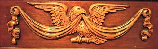 American Eagle Carving. Wood fine carved furniture piece Royalty Free Stock Image