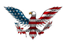 American eagle colored in USA flag colors. American eagle icon with outstretched wings holds bundle of arrows and olive branch in talons, for tattoo or t-shirt Royalty Free Stock Image