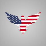 American eagle with flag on a gray background Royalty Free Stock Images