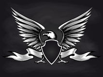American eagle with shield on blackboard. White and black american bald eagle with shield, wings and ribbon on blackboard background. Vector illustration Royalty Free Stock Image