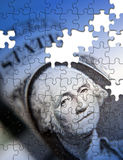 The American economy. Jigsaw pattern applied to  American dollar note Royalty Free Stock Photography
