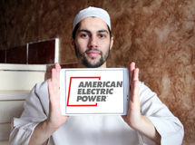 American Electric Power, AEP logo. Logo of energy and home services company American Electric Power, AEP on samsung tablet holded by arab muslim man stock photo
