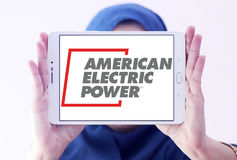 American Electric Power, AEP logo. Logo of energy and home services company American Electric Power, AEP on samsung tablet holded by arab muslim woman royalty free stock photos