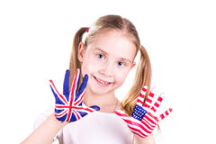 American and English flags on child's hands. Learning English language concept Royalty Free Stock Images